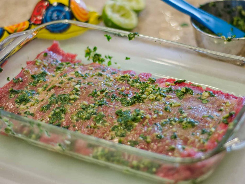 Skirt Steak before grilling with garlic cilantro rub applied
